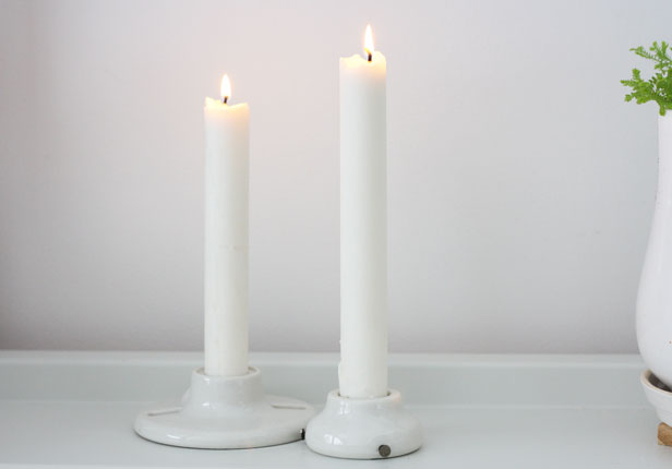 Porcelain sockets upcycled as candlesticks.