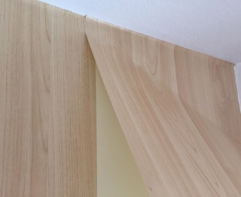 How to install lengths of adhesive wallpaper.