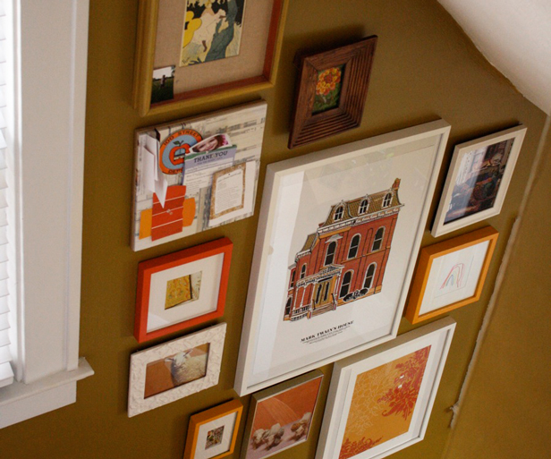 How to install a gallery wall in a stairwell.