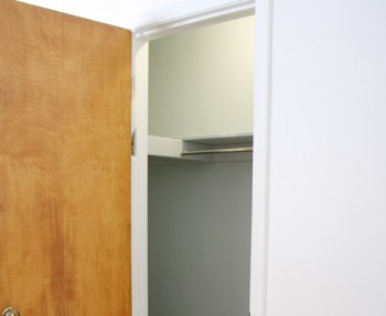 A simple closet, before being transformed into a functional, usable space.