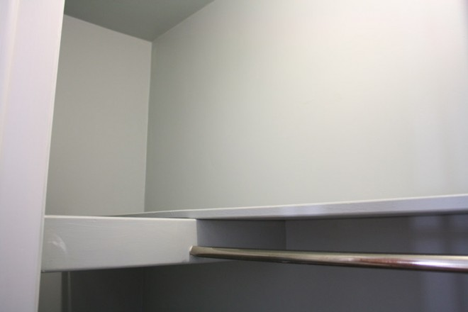 A closet that's deep and hard to access through a small doorway.