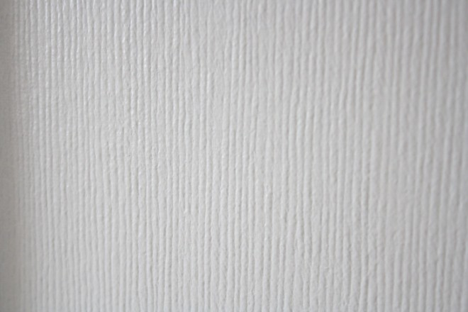 Painting textured wallpaper for a new look.