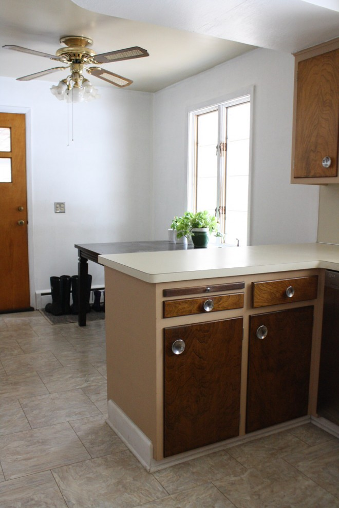 Making over an outdated kitchen with painted wallpaper and trim.