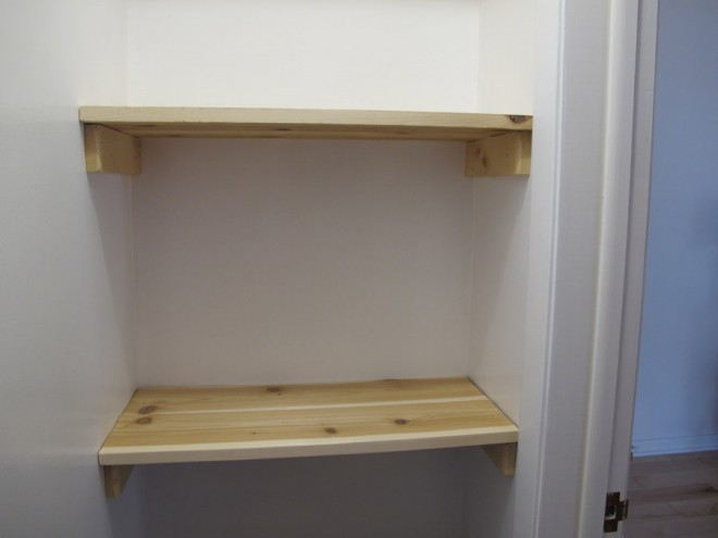 Cedar shelves in an updated bedroom closet.