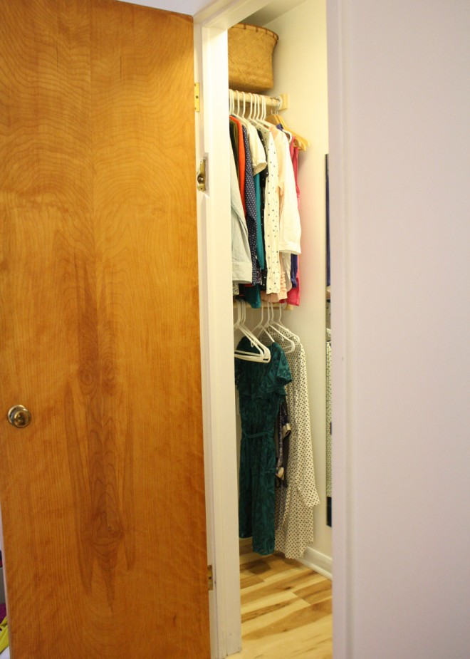 An ordinary closet, redesigned as a modest, functional walk-in closet.