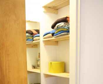 An ordinary closet, redesigned as a modest, functional walk-in closet.