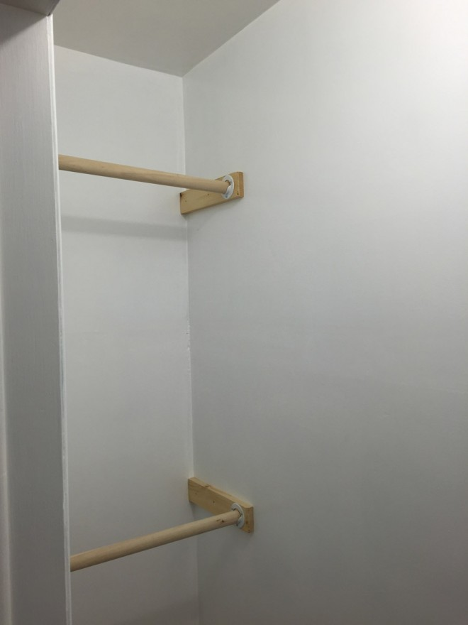 Installing new wooden closet shelving.