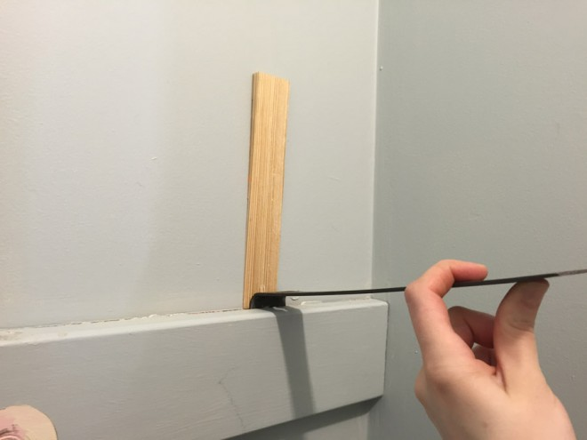 Removing shelving from a closet and reconfiguring the shelving.