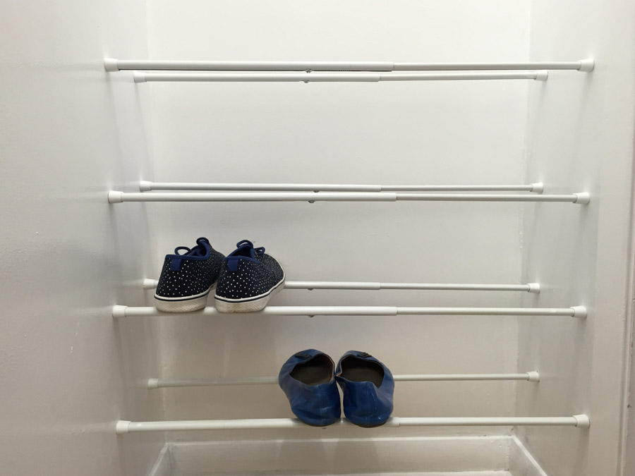 Superb Use Tension Rods To Store Shoes In A Closet.