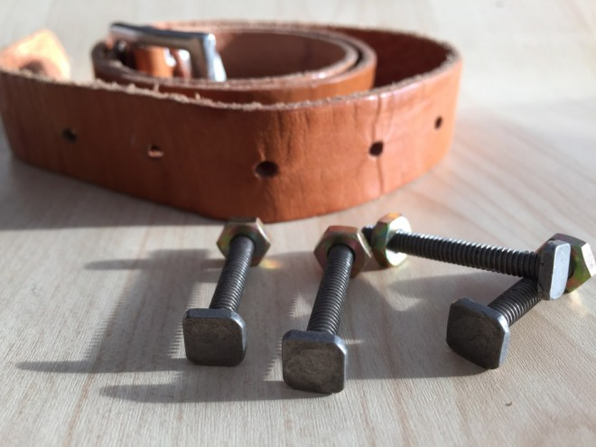 Choosing vintage hardware and a leather belt for custom cabinet pulls.