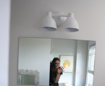 Moving an electrical box and installing a new light over a modern vanity.