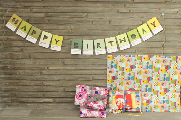 Making a birthday banner using postcards.