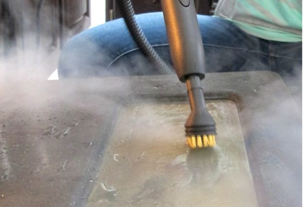 Use a steam cleaner to clean the inside of a charcoal grill.