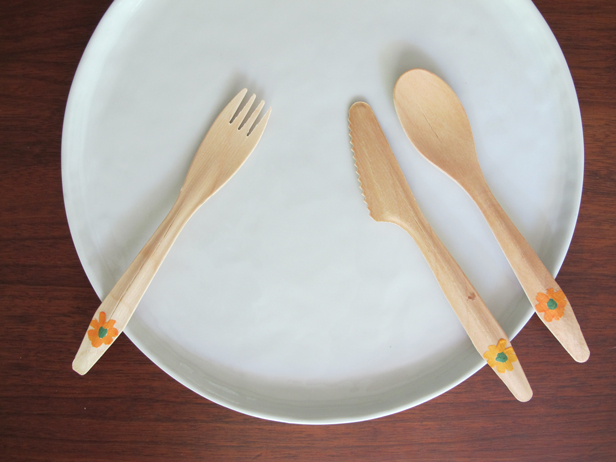 Floral accents on wooden flatware.