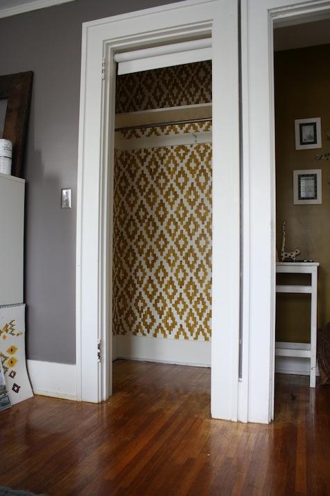 Painting an ikat pattern inside a boring closet.