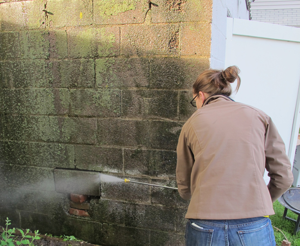 How to use a pressure washer to clean cinder block.