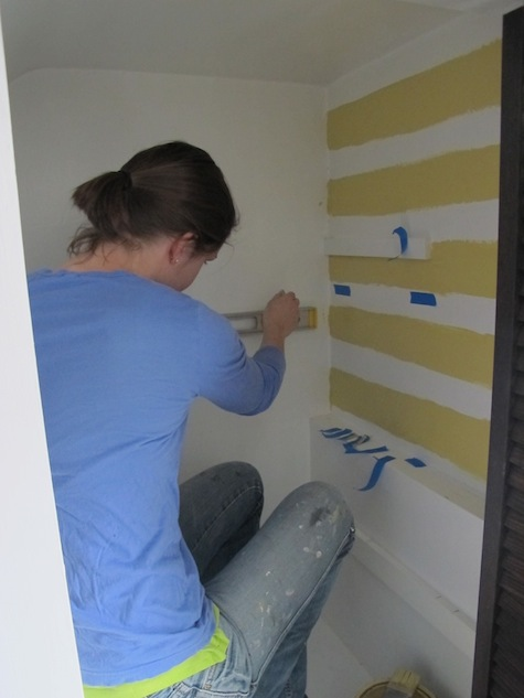 Free handing stripes to decorate the inside of a closet.