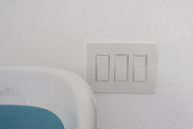 Modern toggle switches during a kitchen electrical upgrade.