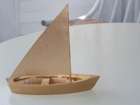 Upgrade a thrifted boat with shiny gold paint.
