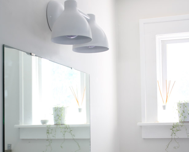 Use a large mirror to boost natural lighting in a small bathroom.