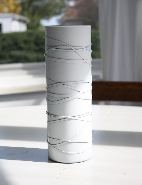 DIY faux aspen or white birch tree vase using rubber bands and layered spray paint.