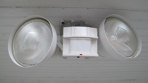 Installing a new motion light on the front of the garage for security and convenience.