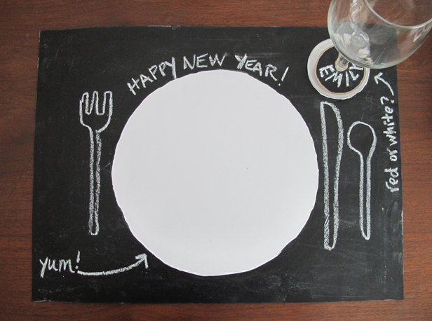 Chalkboard painted placemats for whimsical decor.