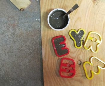 How to make cement letters using cookie cutters.