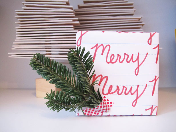 Cursive lettering on wrapping paper for the holidays.