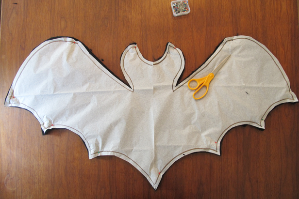 Make a bat-shaped decorative throw pillow for your kids at Halloween.