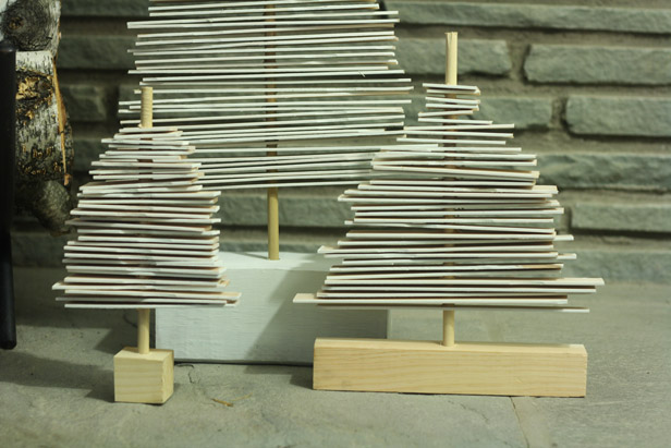 DIY holiday decor - using paint stirrers to make modern wooden christmas trees.