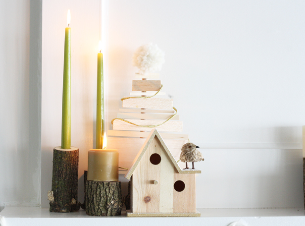 Transform logs into candlesticks, and make a wooden tree for a modern mantel decoration.