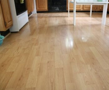 Kitchen Floor with light wood laminate.