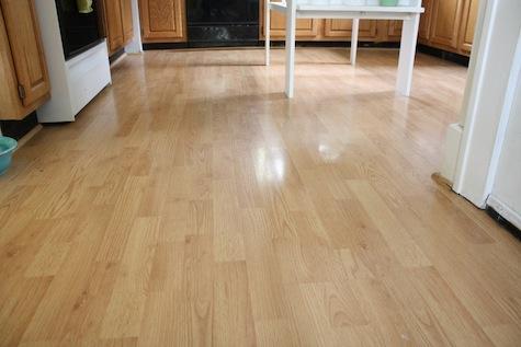 Kitchen Floor with light wood laminate.