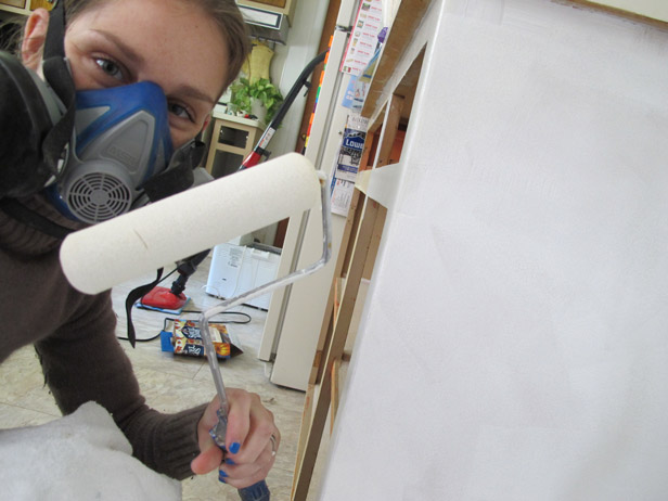 Priming kitchen cabinets for paint.