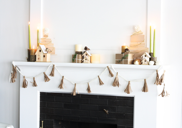 Holiday rustic mantel made of natural finishes.