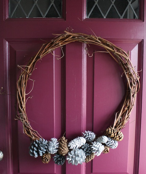 Decorate a wintery wreath with painted pinecones.