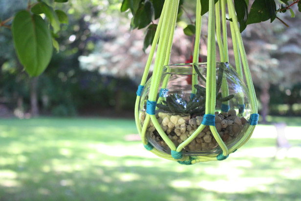 Use colorful rope to make a wrap for a woven hanging basket.