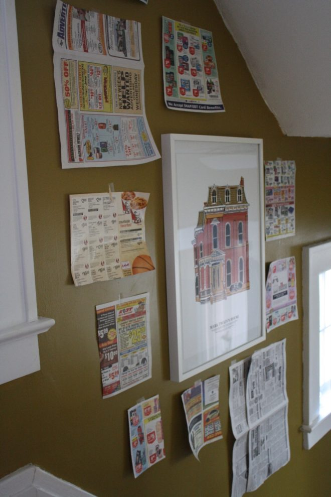 Stairwell gallery wall of picture frames DIY.