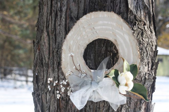 Make a rustic wreath using a cross-section of a tree.