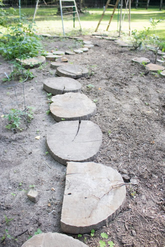 Garden pathway using free wood chip mulch and log border.
