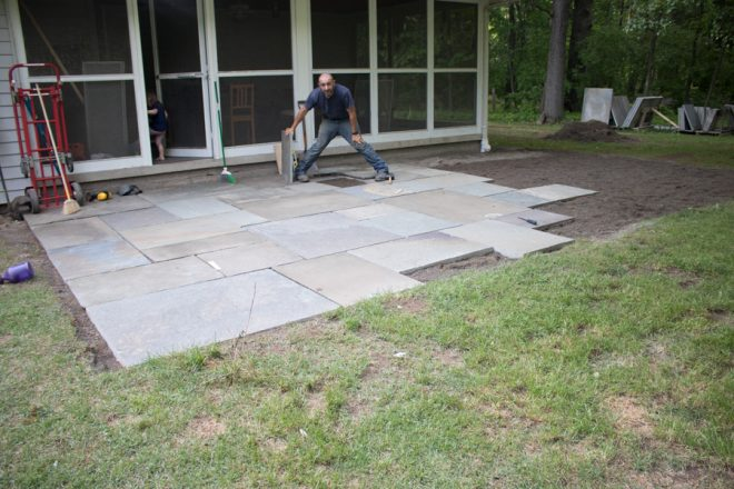 Installing flagstones for our new big patio.