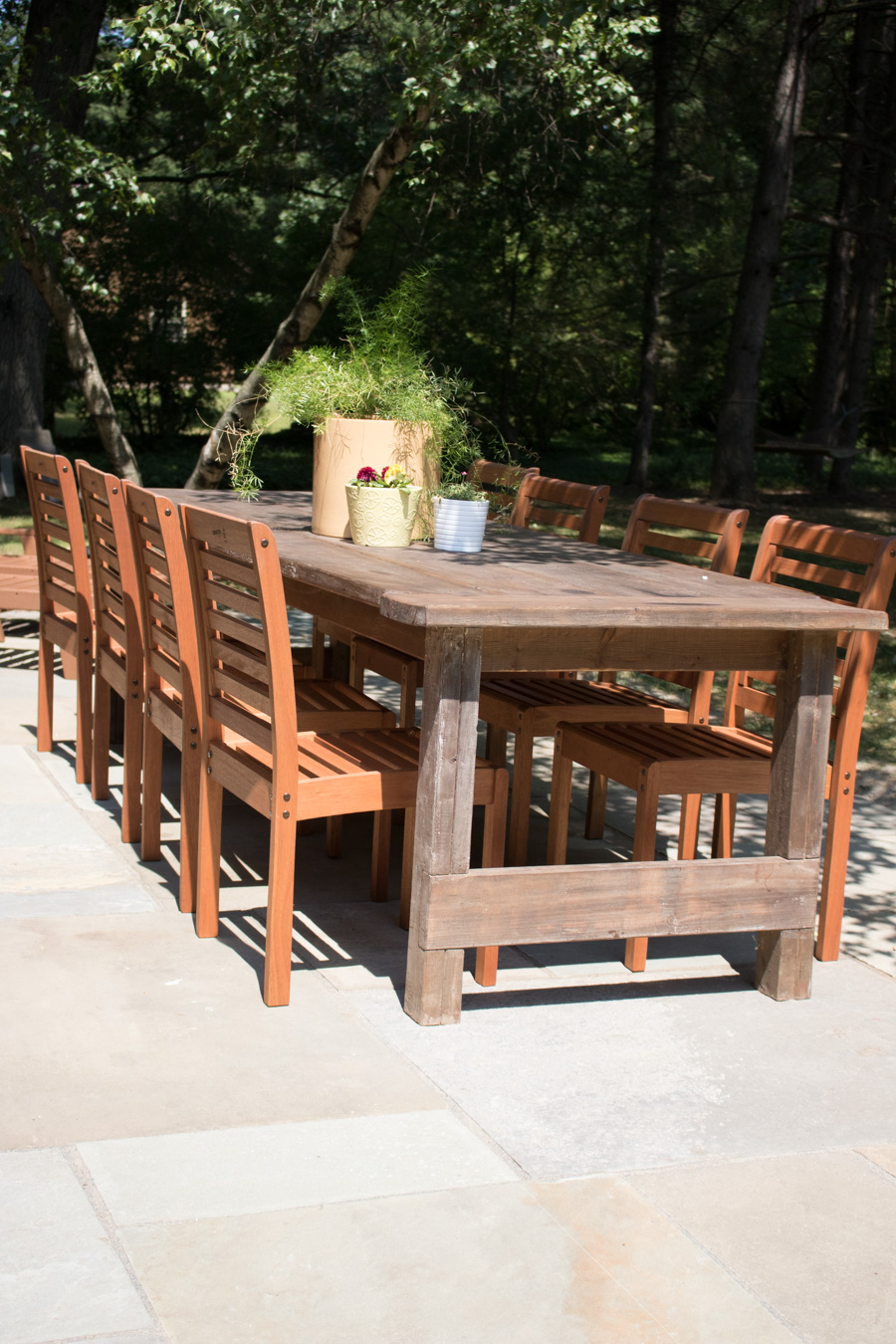 Unique Eucalyptus stackable outdoor dining chairs from Lowe us for our flagstone patio