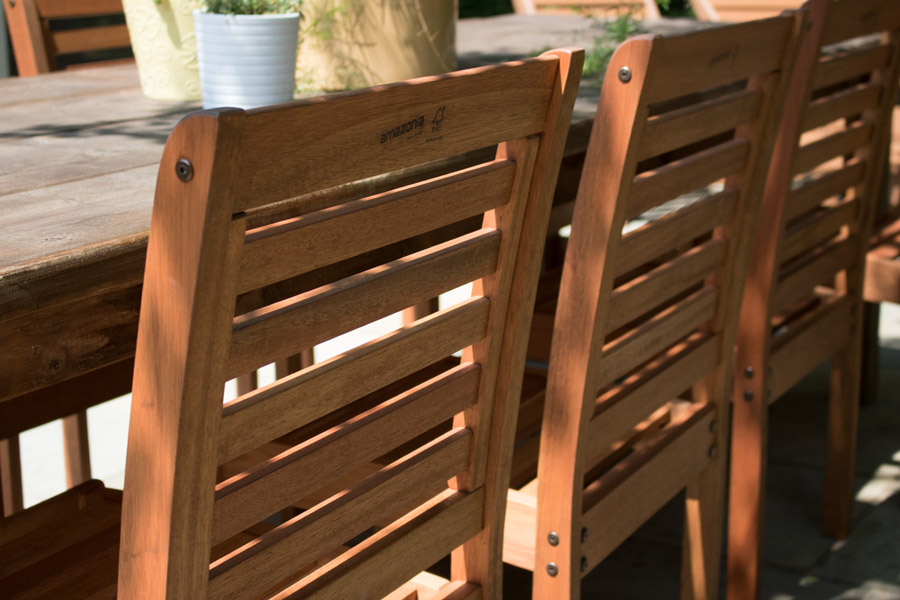 Beautiful Eucalyptus stackable outdoor dining chairs from Lowe us for our flagstone patio