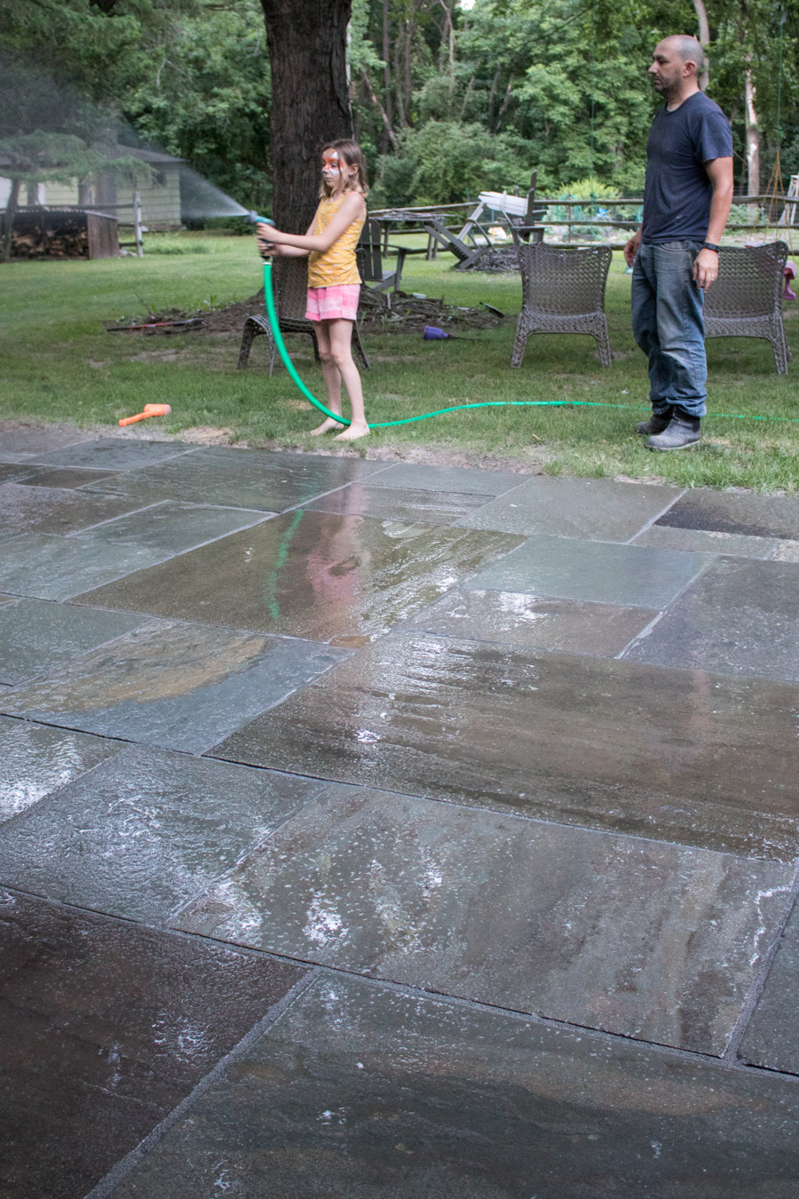 Wetting Polymeric Sand During Our Patio Installation.