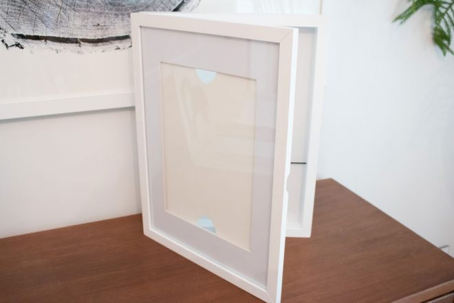 A hinged kid's artwork shadowbox frame for a DIY light box.