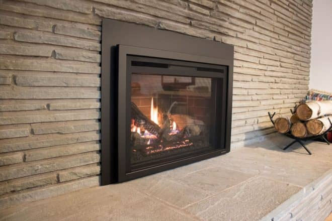 A new Heat & Glo gas fireplace insert from Heat & Glo with very realistic looking embers and flames.