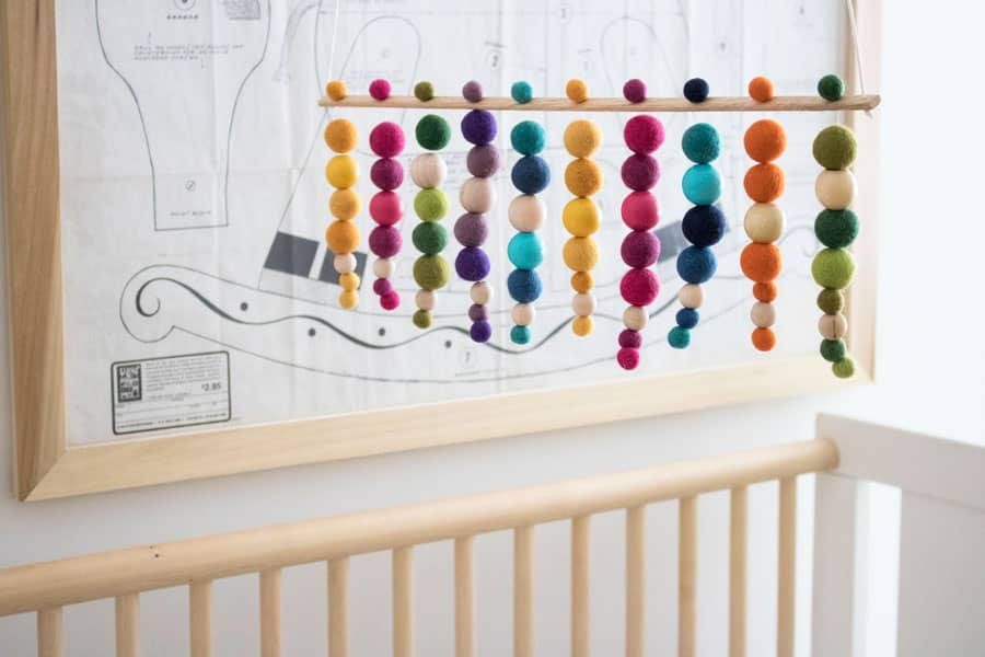a colorful handmade beaded mobile for the babyu0027s nursery