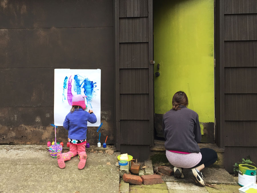 Painting doors with a toddler.
