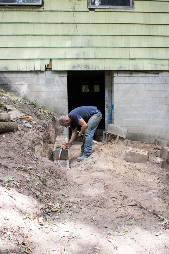 Rebuilding a retaining wall near our two-story barn.